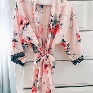 Never worn before bathrobe